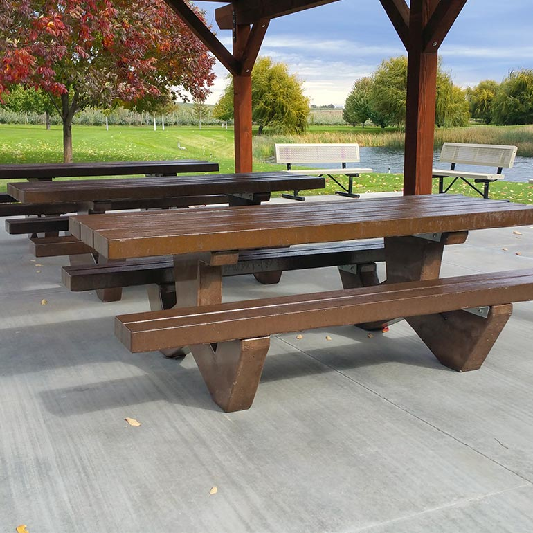 Cement tables and concrete picnic tables.