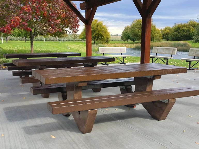 Commercial cement picnic tables and and exposed aggregate stone benches.