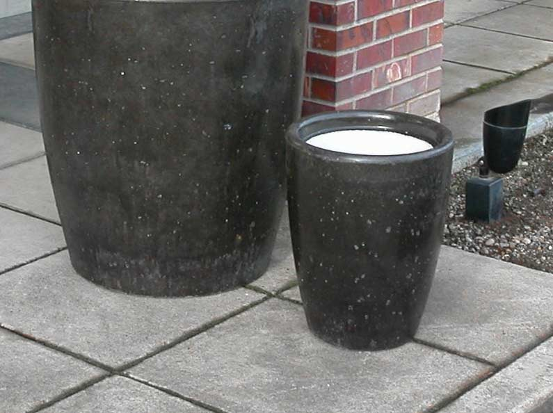 Concrete ash urns and commercial cement cigarette receptacles.