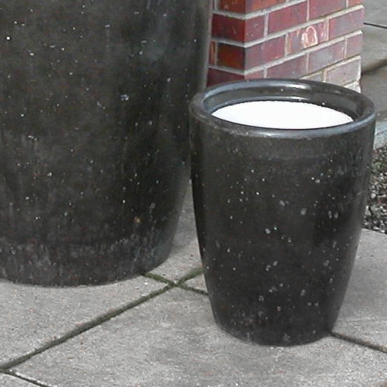 Concrete ash urns and cement cigarette receptacles.