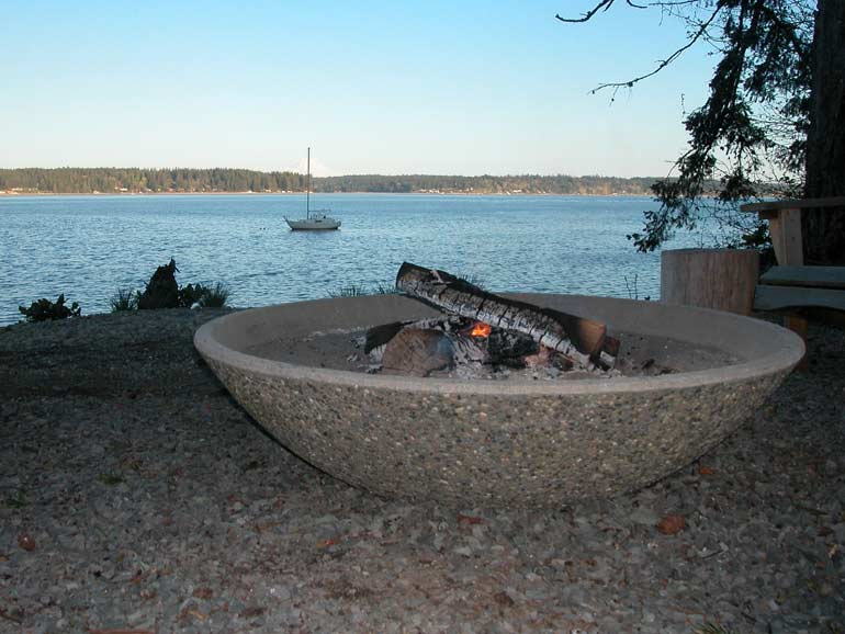 Large concrete fire pits for your home and other cement site furnishings.