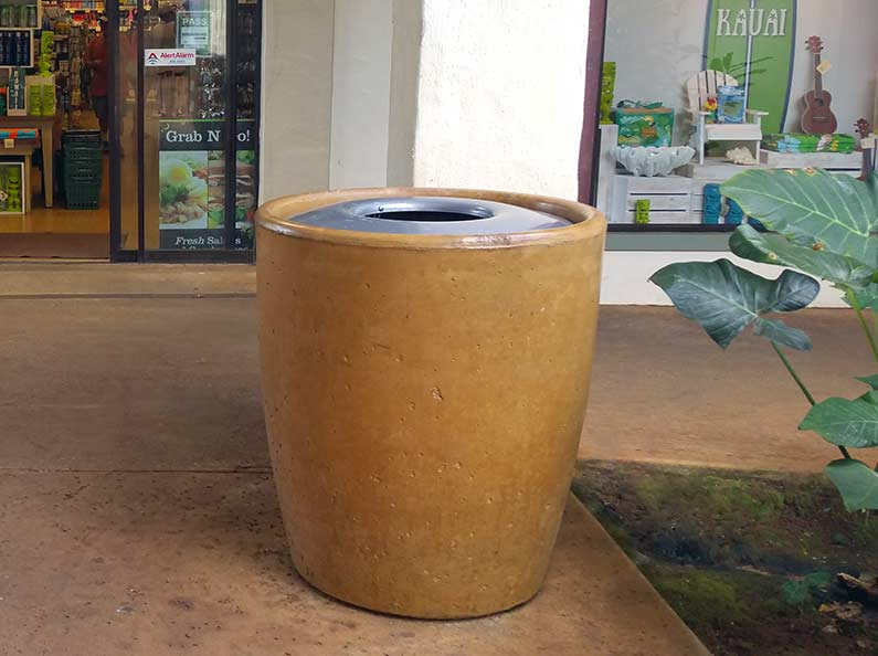 Straw stained concrete waste receptacle from the Xinh collection.