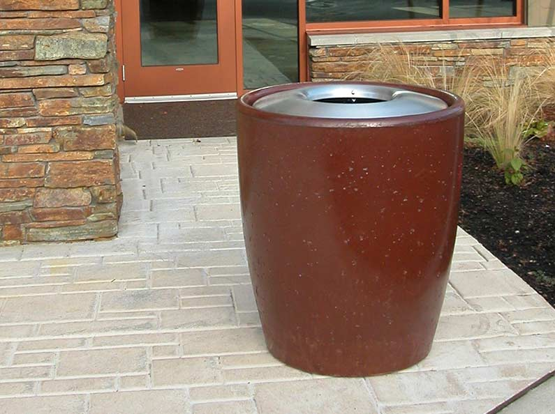 Bark stained concrete waste receptacle from the Xinh collection.