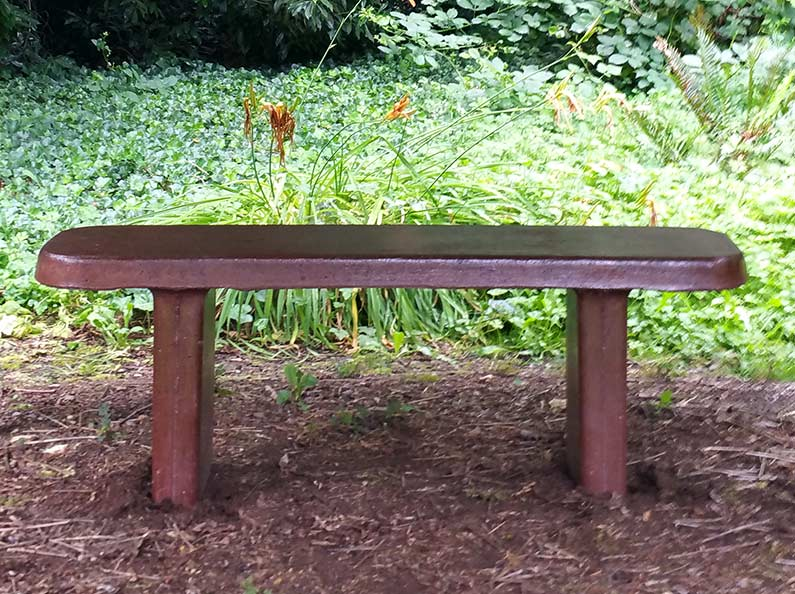 Concrete bench with bark stain finish for a natural look.