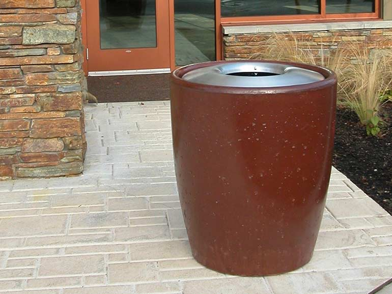 Large concrete trash cans and cement waste receptacles.