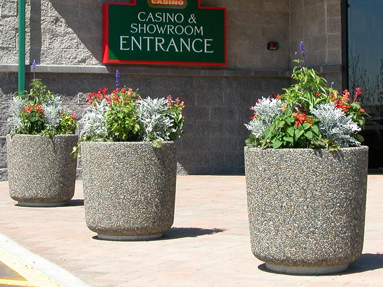 Large concrete street planters manufactured by Ornamental Stone Inc.