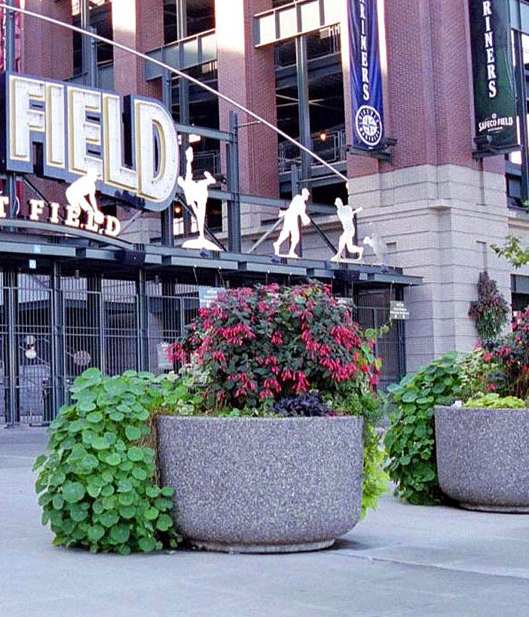 Large concrete street planters and exposed aggregate cement pots from Ornamental Stone Inc.